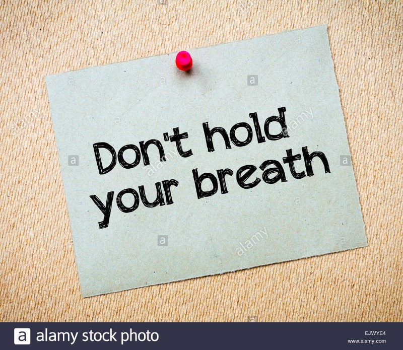 dont-hold-your-breath-message-recycled-paper-note-pinned-on-cork-board-EJWYE4.jpg